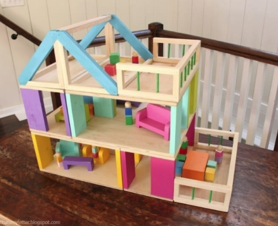A doll house which is made from scrap wood