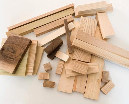 A pile of scrap wood blocks of different variations