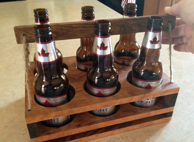 A bottle holder that is made from wood